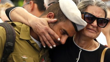 A comrade of 20-year-old Israeli army Staff Sergeant Amit Yeori mourns during his funeral at the Mount Herzl military cemetery in Jerusalem on Sunday.