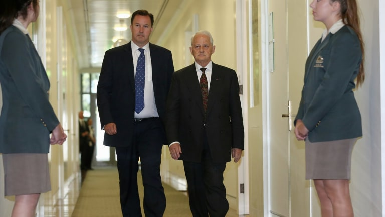 Philip Ruddock (right) departs Monday's Liberal party room meeting to announce the result.
