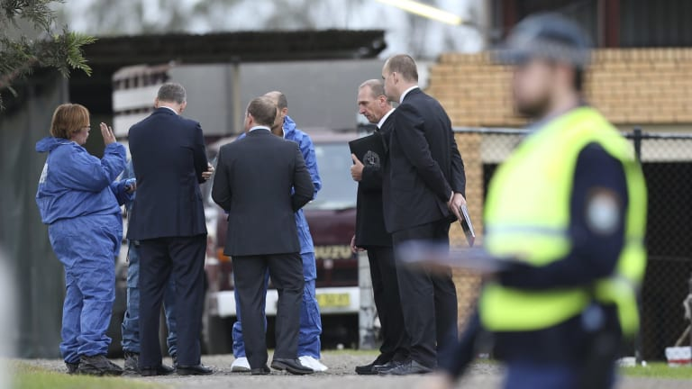 Detectives at the scene of the Badgerys Creek home invasion.