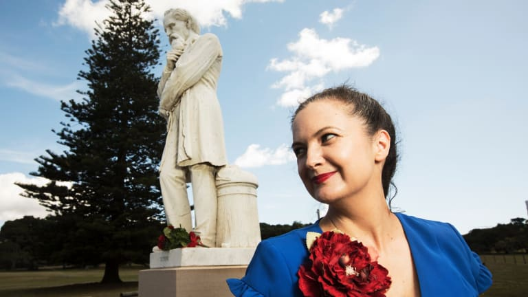 Louise Owens beside the mysterious Charles Dickens statue at Centennial Park.