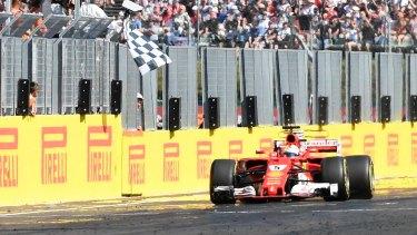 Ferrari's Sebastian Vettel crosses the line to claim victory.