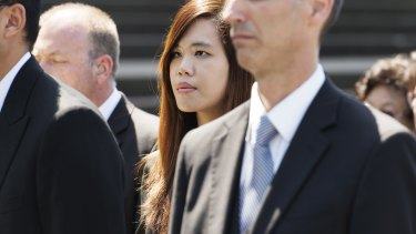 Curtis Cheng's daughter Zilvia attends her father's funeral.