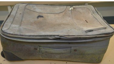The suitcase in which the remains were found, and a tutu and shoe found with the body.