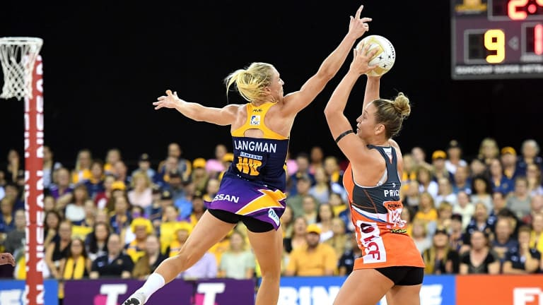 The Giants' Jamie-Lee Price is pressured by the defence of Laura Langman.