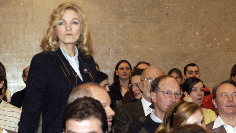 A file photo showing former Australian beauty queen and London socialite Michele Renouf at a Vienna court in 2006. She was there in support of British historian David Irving, who had pleaded guilty to charges of denying the Holocaust.