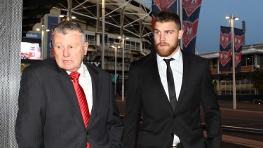 Dragons fullback Josh Dugan, right, arrives at a judiciary hearing on July 29, 2015 for an unrelated matter.