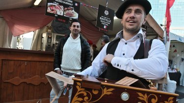 Vincent Hernandez, left, organiser of the Bastille Festival at Circular Quay with Maxime Peyrot playing the Barbarian Organ.