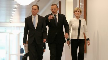 Environment Minister Greg Hunt, Prime Minister Tony Abbot and Foreign Affairs Minister Julie Bishop at Parliament House.