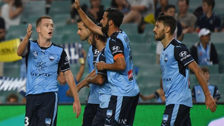 Field day: Brandon O'•Neill gets in on the act and is congratulated by skipper Alex Brosque.