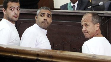 Peter Greste (right) appears in court along with other defendents during their trial on terror charges in Cairo, Egypt.