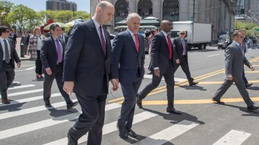 Malcolm Turnbull walks towards New York's Ted Weiss Federal Building with FBI Assistant Director, William F. Sweeney.