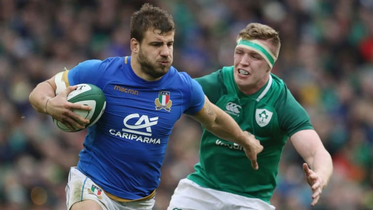 Italy's Tommaso Castello, left, gets away from Ireland's Dan Leavy.