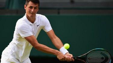 Bernard Tomic will miss the Davis Cup quarter-finals.