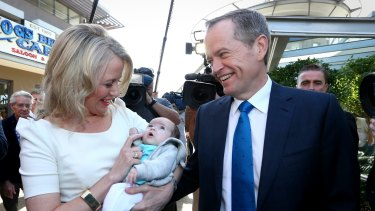 Opposition Leader Bill Shorten and Chloe Chorten meet with 6-week-old baby Lexi-Rose during a street walk in Queensland.