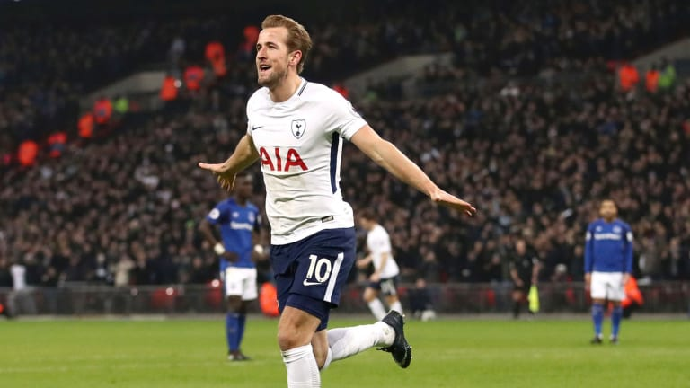 Kane plane: Harry Kane celebrates scoring Tottenham's third.