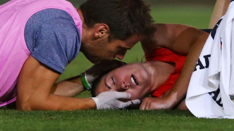 Meg Downie in trouble on Saturday night after the collision that has earned Magpie Sophie Casey a suspension.