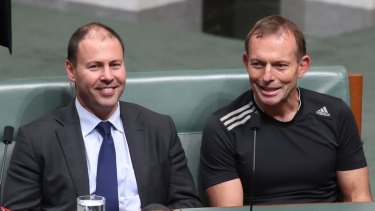 Mr Frydenberg sits alongside former prime minister Tony Abbott during a parliamentary vote last month.