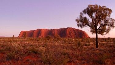 Uluru towers 348 metres above the surrounding plain.