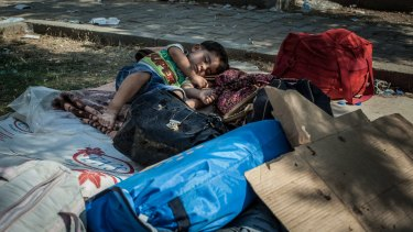 A child sleeps in a public park in Akcakale, Turkey, where some Syrian refugees have been staying.