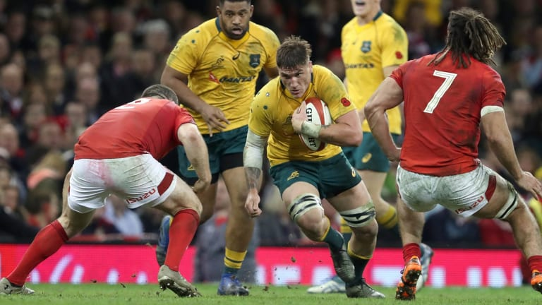 Tough style: Australia's Sean McMahon takes on the Wales defence earlier this month.