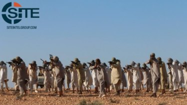 This image posted online on February 5, 2016, by supporters of the Tripoli Province of the Islamic State in Libya on a social media site, and vetted by SITE Intel Group, shows fighters training at a camp in Libya.