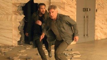 Ryan Gosling, left, and Harrison Ford in <i>Blade Runner 2049</i>.