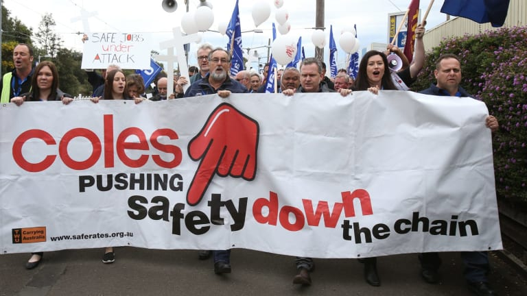 Downward slide: SMH transport workers hold a protest rally  to highlight the lethal squeeze from supermarket giant Coles on truck drivers.