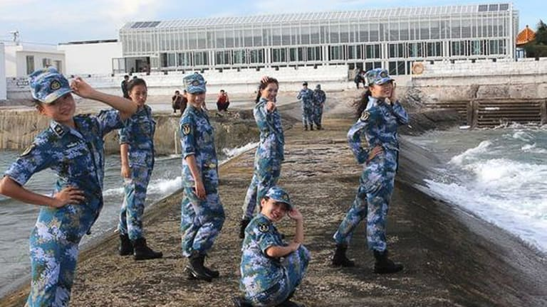 This propaganda image from the Chinese newsite sina.com shows Chinese soldiers posing in front of newly constructed buildings on Fiery Cross Reef.
