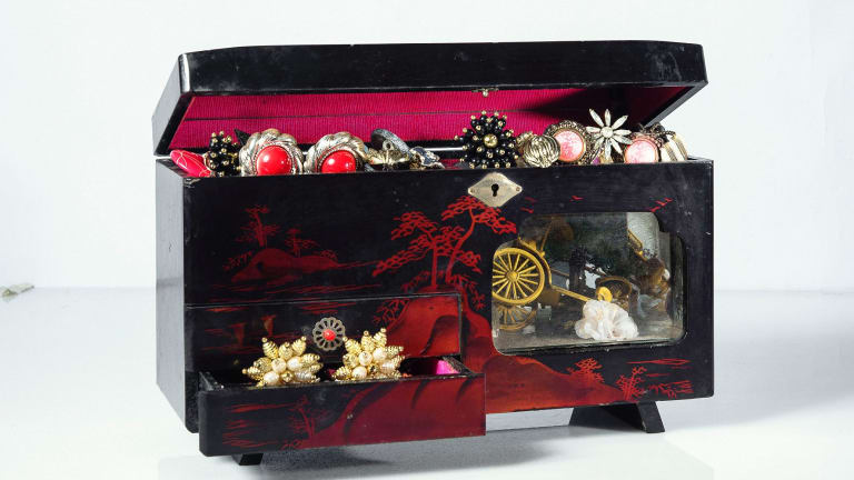 The jewellery box, poignantly missing a tiny red handle from one of its drawers.