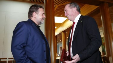 Corridors of power: Russell Crowe meeting Barnaby Joyce at Parliament House in May.