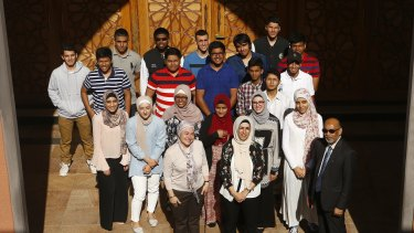 Malek Fahd students pose for a picture with principal Aiyub Ahmed and teachers Tulin Bragg and Houda Kabbr.