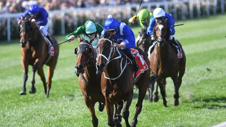 Super mare: Hugh Bowman rides Winx to victory in the Cox Plate ahead of Humidor in October.