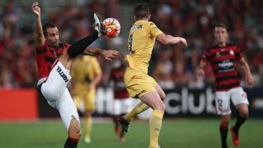 Good skills:  Alberto of the Wanderers clears the ball as Roy O'Donovan of the Mariners takes evasive action.