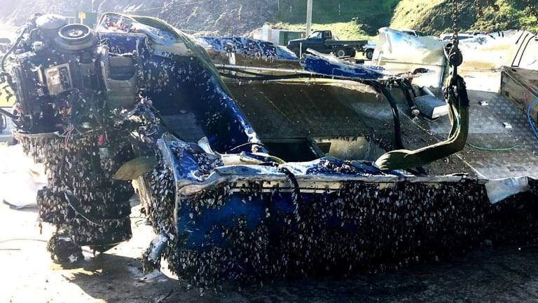 The fishing boat covered in barnacles after its six months at sea.