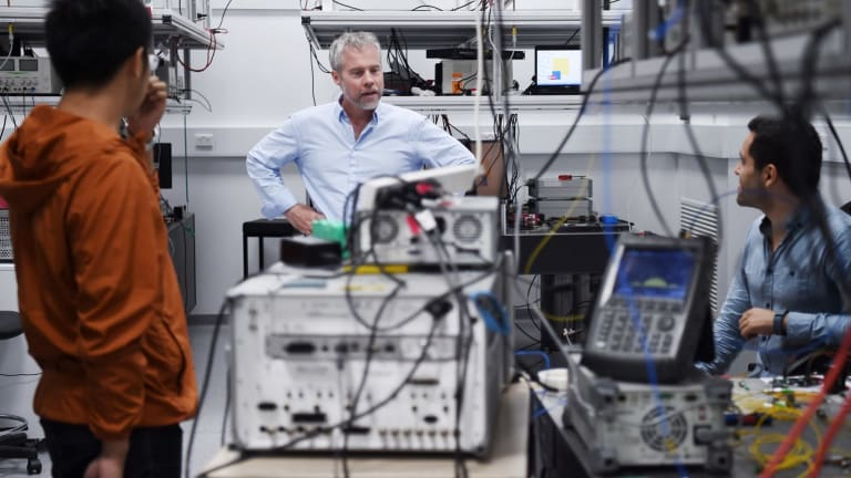 Professor Ben Eggleton (centre) in his lab at the Nanoscience Hub.