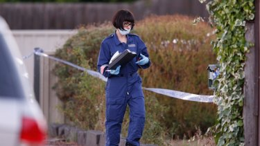 Police and forensic experts investigate after a woman and child were found dead in a house in Pascoe Vale.