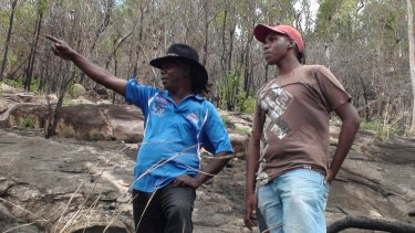 Tracker Victor Huddleston and his son Victor Nathaniel searching for Mick in 2009.