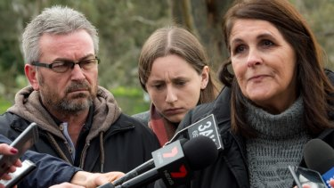 Karen's husband, Borce, their daughter, Sarah, and Karen's aunt Patricia Gray, speak to the media last year.