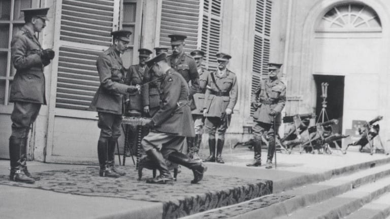 King George V, knighting Lieutenant-General Sir John Monash, Australian Corps commander, at the corps headquarters in August 1918.