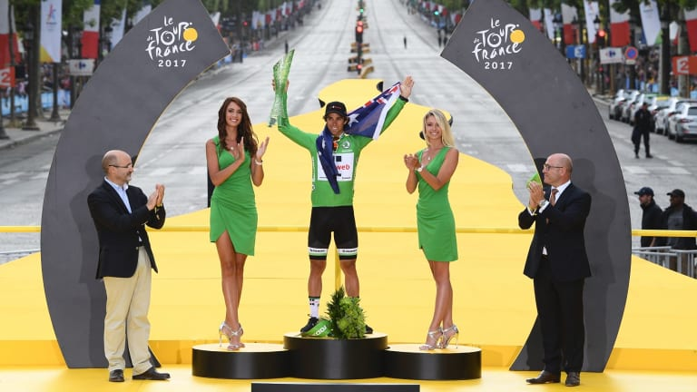 Australian rider Michael Matthews is flanked by so-called 'podium girls' after winning the green jersey for Team Sunweb at last year's Tour de France.