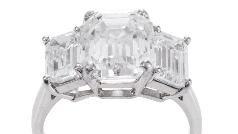 A three-stone diamond ring.