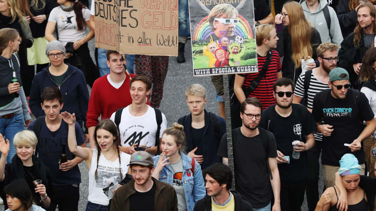 Demonstrators hold a 'Night Dance' protest ahead of the G20 summit.