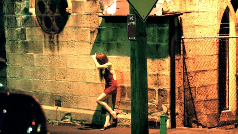 No choice: Modern slavery takes many forms, including sex trafficking. A prostitute stands on a street corner.