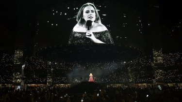 Adele felt compelled to point out her big-screen image had some flattering filters on it.
