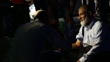 A passenger's blood pressure is checked by health officials outside  Istanbul Ataturk after the attack.