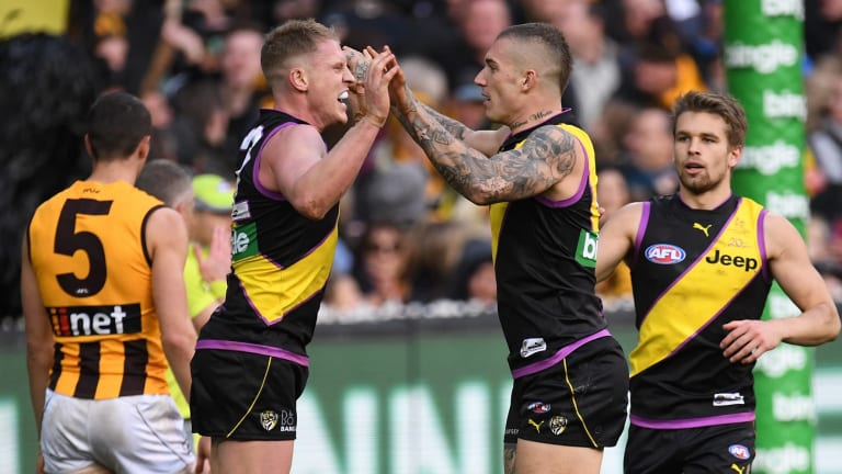 Up and at 'em: Josh Caddy and Dustin Martin celebrate another six points for the Tigers.
