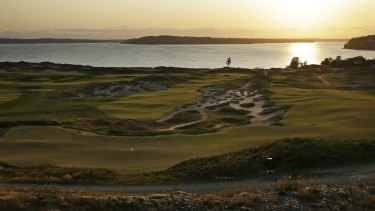 House of pain: Chambers Bay, which is serene at sunset, will test the world best golfers in this week's US Open.
