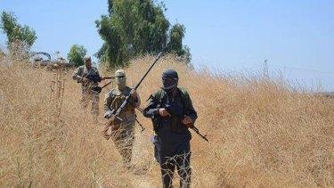 Islamic State militants patrol Khazer, near Mosul.