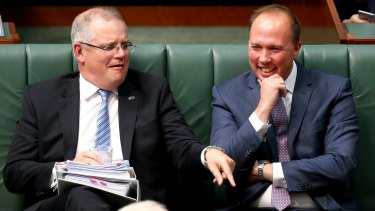 You don't want to know what sort of joke would make Scott Morrison and Peter Dutton laugh this hard. That said: what's Scotty pointing at?