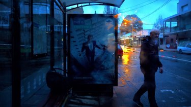 A man waits at a shelter for a bus in Leichhardt on Wednesday.